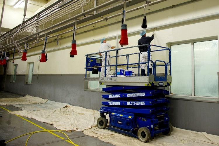 Schilderwerk wanden fabriek Tilburg